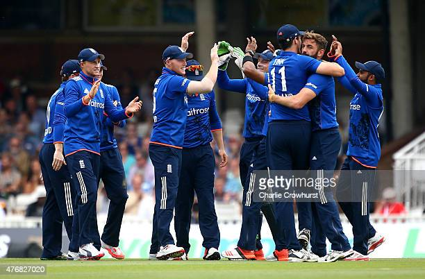 Liam Plunkett of England celebrates with team mates after taking the wicket of Brendon McCullum of New Zealand hits out during the the 2nd ODI Royal...