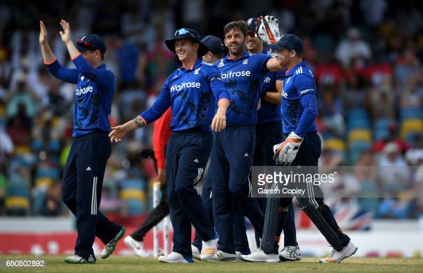 Liam Plunkett of England celebrates with teammates after dismissing Shai Hope of the West Indies during the 3rd One Day International between the...