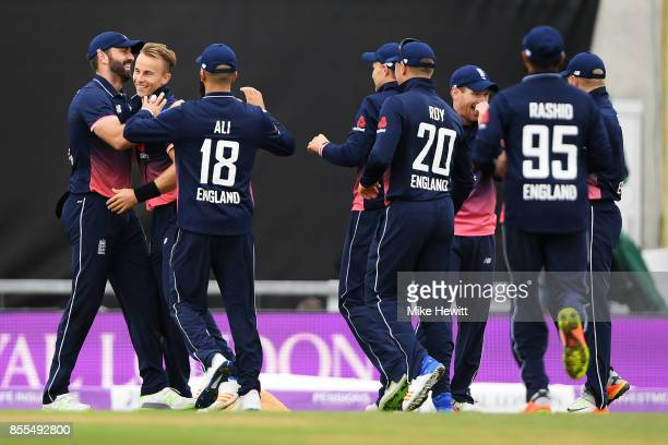 Liam Plunkett of England celebrates with Tom Curran and team mates after taking a spectacular catch to dismiss Chris Gayle during the 5th Royal...