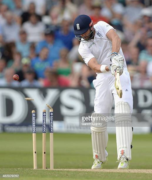 Liam Plunkett of England is bowled by Bhuvneshwar Kumar of India during day three of 1st Investec Test match between England and India at Trent...