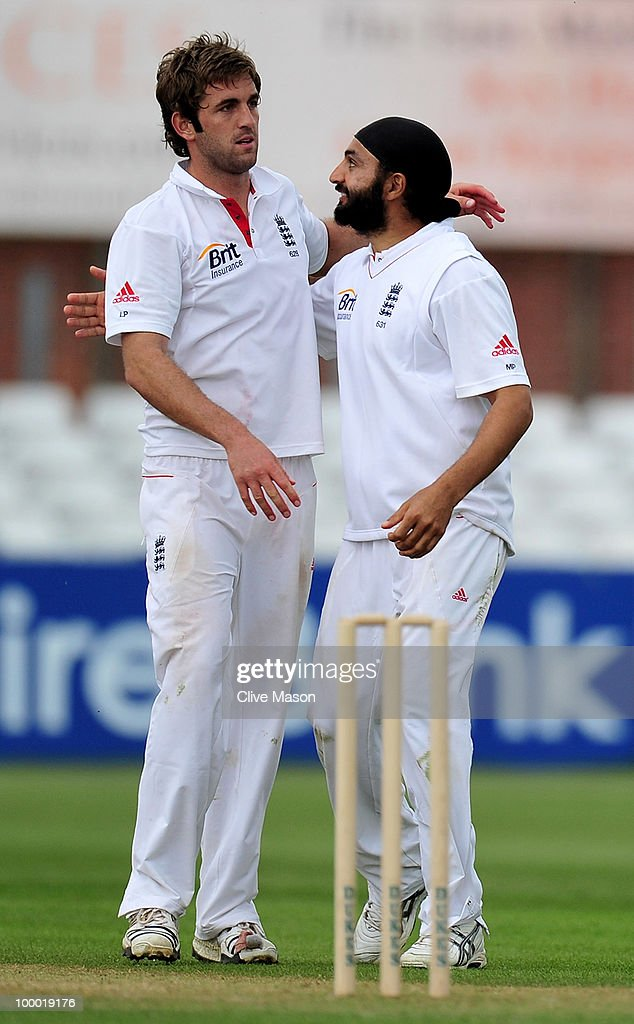 Liam Plunkett of England Lions celebrates a wicket with team mate Monty Panesar during day two of the match between England Lions and Bangladesh at The County Ground on May 20, 2010 in Derby, England.