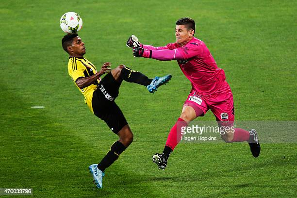 Liam Reddy of the Mariners clears a ball from the challenge of Roy Krishna of the Phoenix during the round 26 ALeague match between the Wellington...