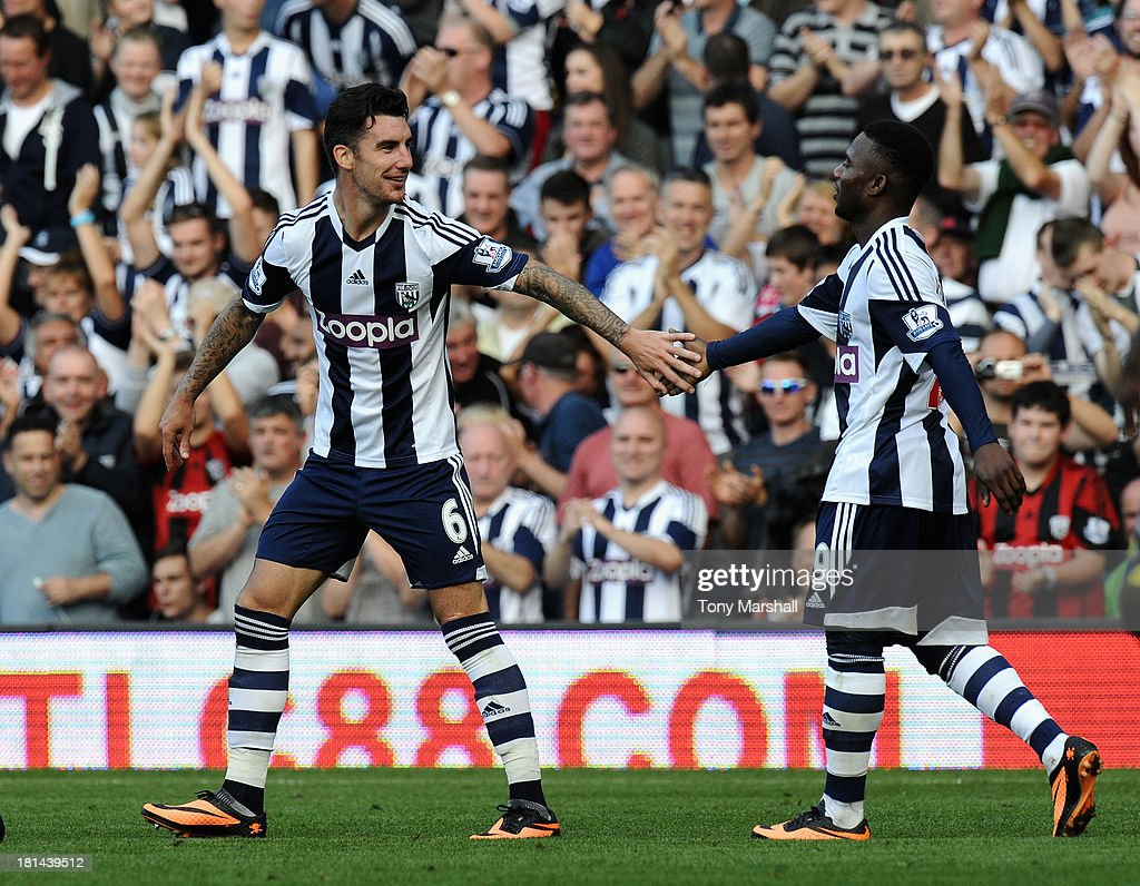 <a gi-track='captionPersonalityLinkClicked' href=/galleries/search?phrase=Liam+Ridgewell&family=editorial&specificpeople=227283 ng-click='$event.stopPropagation()'>Liam Ridgewell</a> (L) of West Bromwich Albion celebrates with Stephane Sessegnon after scoring their second goal during the Barclays Premier League match between West Bromwich Albion and Sunderland at The Hawthorns on September 21, 2013 in West Bromwich, England.