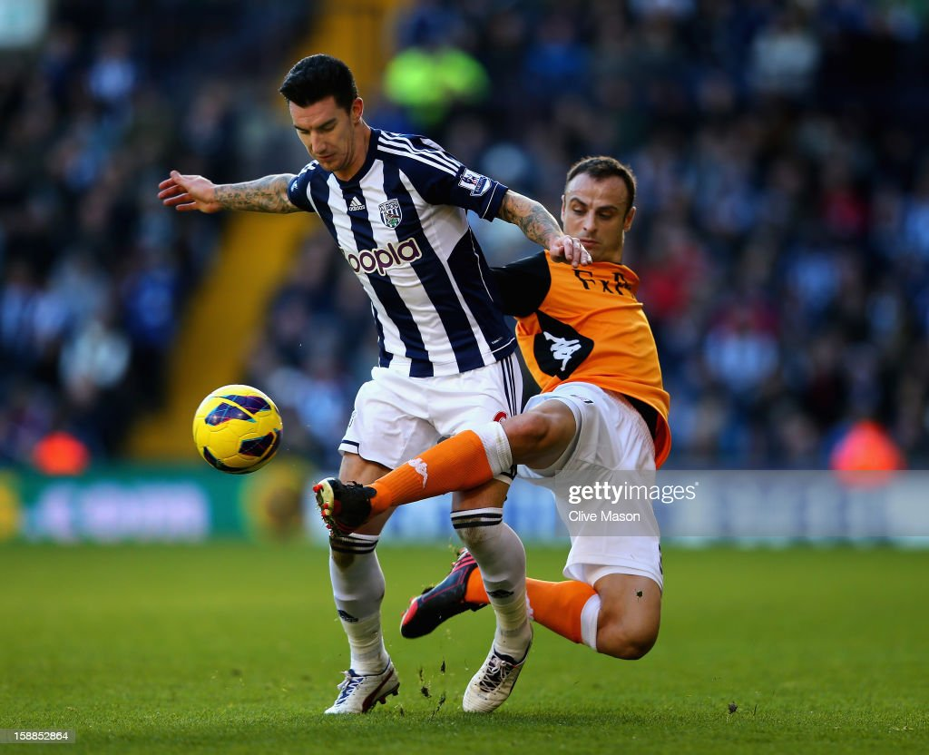 <a gi-track='captionPersonalityLinkClicked' href=/galleries/search?phrase=Liam+Ridgewell&family=editorial&specificpeople=227283 ng-click='$event.stopPropagation()'>Liam Ridgewell</a> of West Bromwich Albion is tackled by <a gi-track='captionPersonalityLinkClicked' href=/galleries/search?phrase=Dimitar+Berbatov&family=editorial&specificpeople=216379 ng-click='$event.stopPropagation()'>Dimitar Berbatov</a> of Fulham during the Barclays Premier League match between West Bromwich Albion and Fulham at The Hawthorns, on January 1, 2013 in West Bromwich, England.