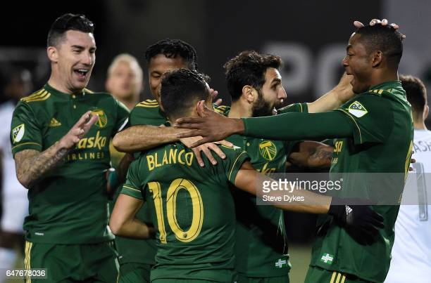 PORTLAND OR MARCH 03 Liam Ridgewell Sebastian Blanco Diego Valeri and Fanendo Adi celebrate after Valeri scored a goal during the second half of the...