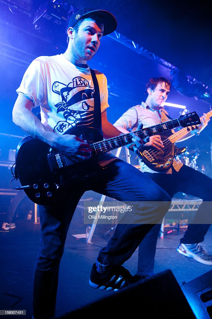 Liam 'Rory' Clewlow and Chris Batten of Enter Shikari Perform onstage during a day of the 5th UK leg of their A Flash Flood of Colour World Tour called A Flash Flood Of Christmas; at Rock City on December 12, 2012 in Nottingham, England.