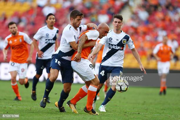 Liam Rose of the Mariners and Massimo Maccarone of the Roar compete for the ball during the round five ALeague match between the Brisbane Roar and...