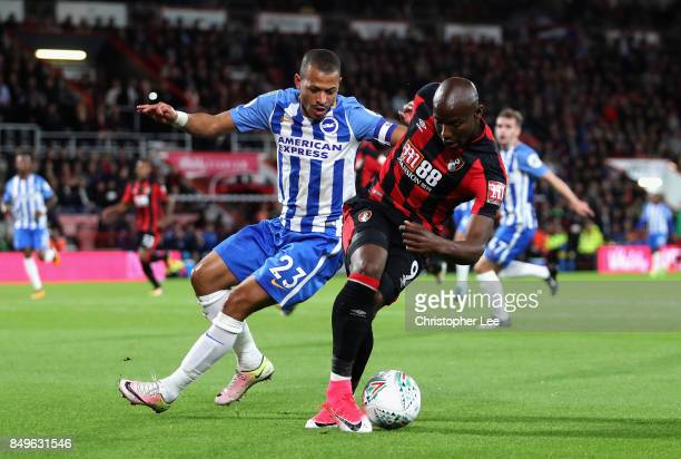 Liam Rosenior of Brighton and Hove Albio and Benik Afobe of AFC Bournemouth battle for possession during the Carabao Cup Third Round match between...