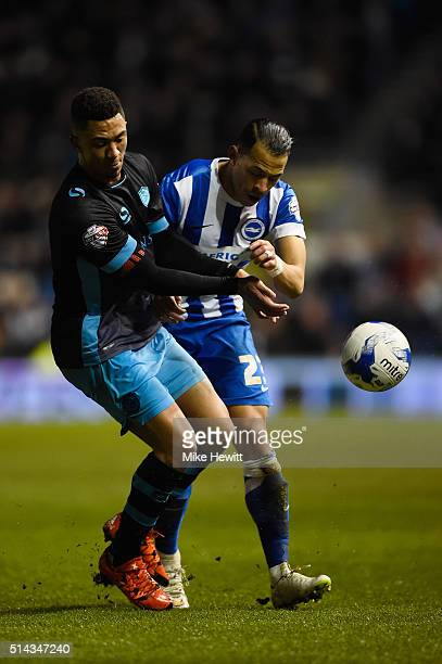 Liam Rosenior of Brighton Hove Albion is challenged by Liam Palmer of Sheffield Wednesday during the Sky Bet Championship match between Brighton and...