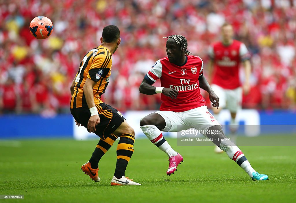 Liam Rosenior of Hull City battles for the ball with Bacary Sagna of Arsenal during the FA Cup with Budweiser Final match between Arsenal and Hull City at Wembley Stadium on May 17, 2014 in London, England.