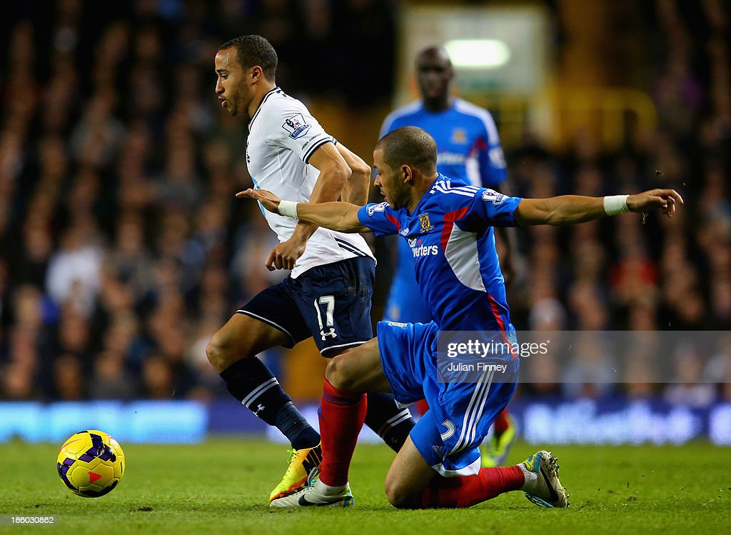 <a gi-track='captionPersonalityLinkClicked' href=/galleries/search?phrase=Liam+Rosenior&family=editorial&specificpeople=224912 ng-click='$event.stopPropagation()'>Liam Rosenior</a> of Hull City tackles <a gi-track='captionPersonalityLinkClicked' href=/galleries/search?phrase=Andros+Townsend&family=editorial&specificpeople=4266573 ng-click='$event.stopPropagation()'>Andros Townsend</a> of Spurs during the Barclays Premier League match between Tottenham Hotspur and Hull City at White Hart Lane on October 27, 2013 in London, England.