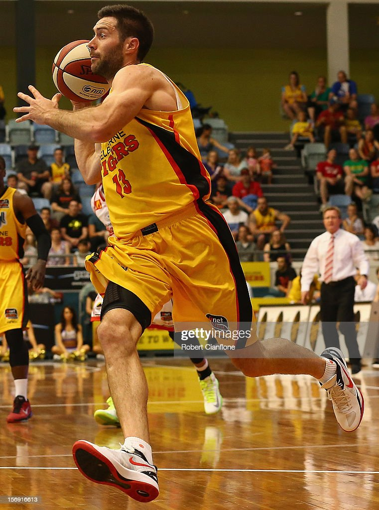 Liam Rush of the Tigers runs with the ball during the round eight NBL match between the Melbourne Tigers and the Wollongong Hawks at State Netball Hockey Centre on November 25, 2012 in Melbourne, Australia.