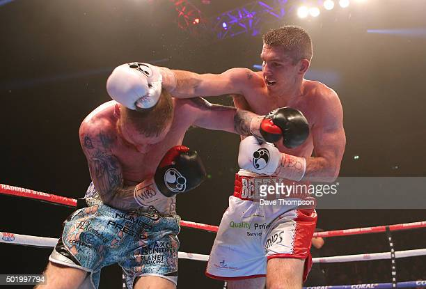 Liam Smith and Jimmy Kelly during their WBO World Super Welterweight title fight at the Manchester Arena on December 19 2015 in Manchester England