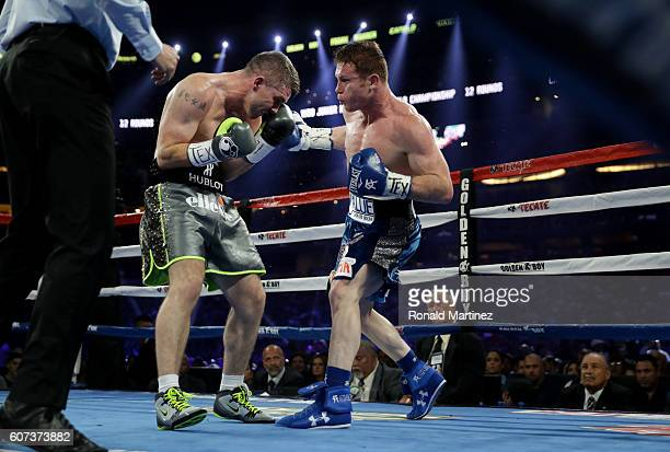 Liam Smith left fights Canelo Alvarez right during the WBO Junior Middleweight World fight at ATT Stadium on September 17 2016 in Arlington Texas