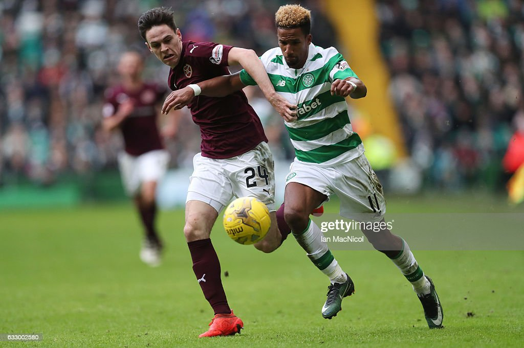 Liam Smith of Heart of Midlothian vies with Scott Sinclair of Celtic during the Ladbrokes Scottish Premiership match between Celtic and Heart of Midlothian at Celtic Park Stadium on January 29, 2017 in Glasgow, Scotland.