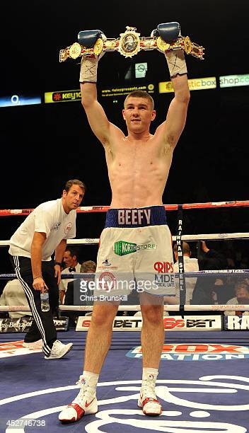 Liam Smith poses with the belt following the British Light Middleweight Championship fight at the Phones 4u Arena on July 26 2014 in Manchester...