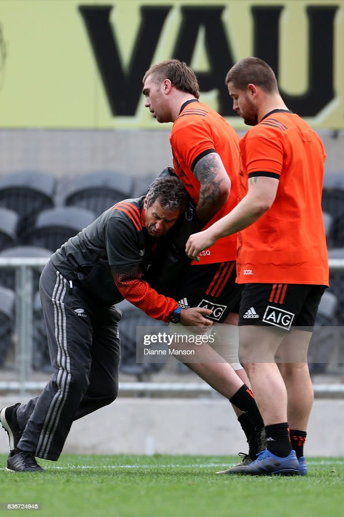 Liam square of the All Blacks is tackle by Wayne Smith, assistant coach, as Dane Coles looks on during a New Zealand All Blacks Training Session on August 22, 2017 in Dunedin, New Zealand.