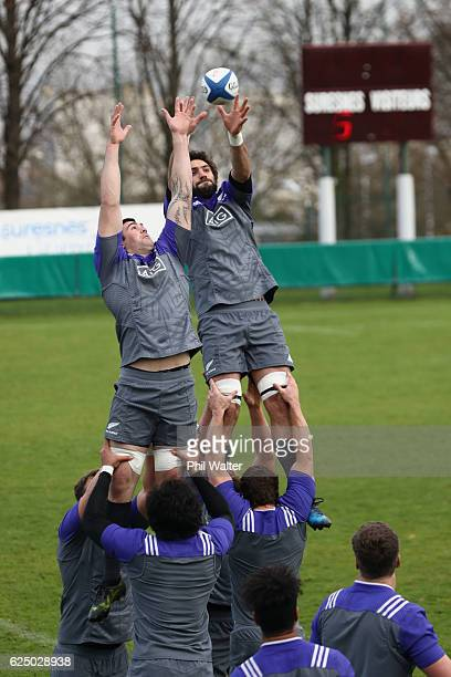 Liam Squire and Sam Whitelock of the New Zealand All Blacks practice the lineout at the Suresnes Rugby Club on November 22 2016 in Paris France