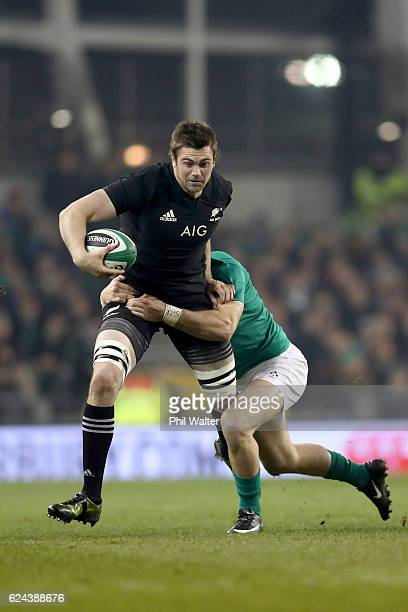 Liam Squire of New Zeaand is tackled during the international rugby match between Ireland and the New Zealand All Blacks at Aviva Stadium on November...