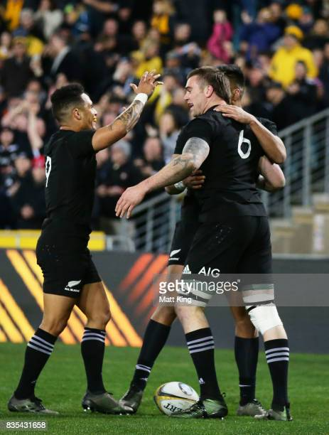 Liam Squire of the All Blacks celebrates with team mates after scoring a try during The Rugby Championship Bledisloe Cup match between the Australian...