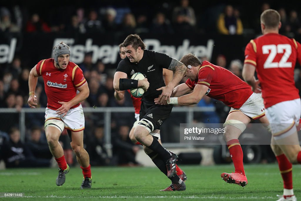 Liam Squire of the All Blacks is tackled during the International Test match between the New Zealand All Blacks and Wales at Forsyth Barr Stadium on June 25, 2016 in Dunedin, New Zealand.