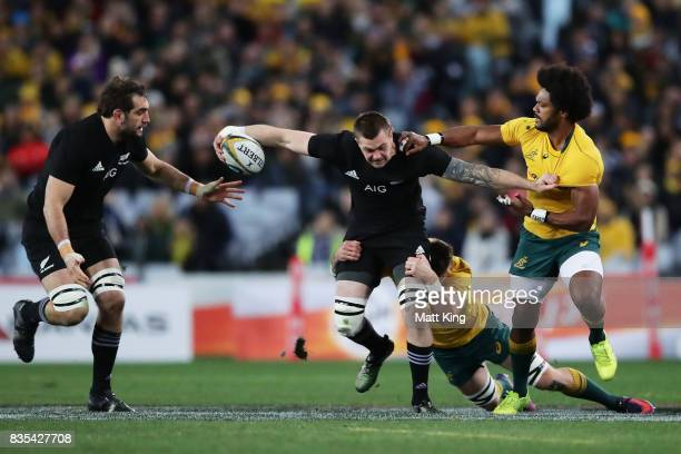 Liam Squire of the All Blacks is tackled during The Rugby Championship Bledisloe Cup match between the Australian Wallabies and the New Zealand All...