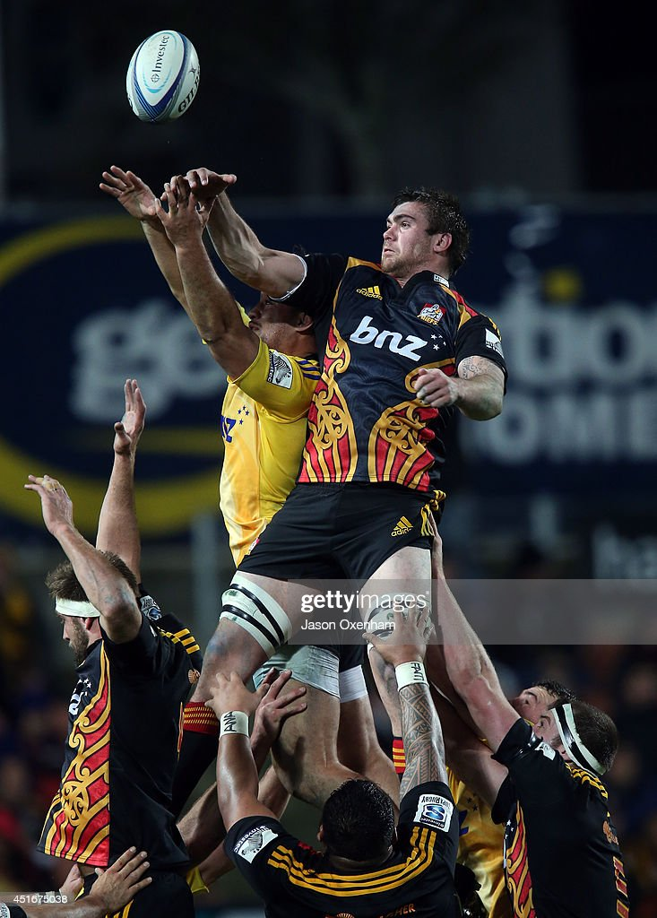 Liam Squire of the Chiefs pinches a lineout off a Hurricanes throw beating Blade Thomson of the Hurricanes during the round 18 Super Rugby match between the Chiefs and the Hurricanes at Waikato Stadium on July 4, 2014 in Hamilton, New Zealand.