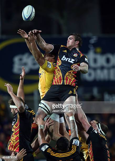 Liam Squire of the Chiefs pinches a lineout off a Hurricanes throw beating Blade Thomson of the Hurricanes during the round 18 Super Rugby match...