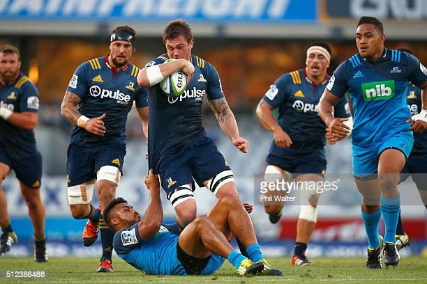 Liam Squire of the Highlanders is tackled during the round one Super Rugby match between the Blues and the Highlanders at Eden Park on February 26...