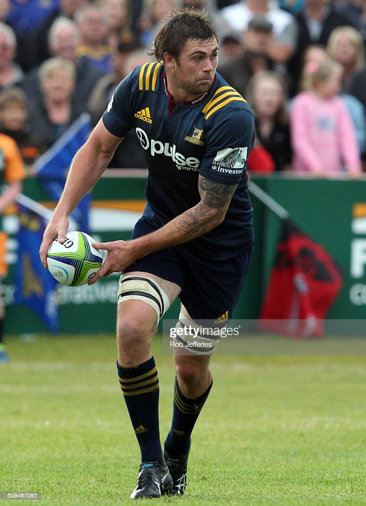 Liam Squire of the Highlanders looks to pass during the Super Rugby trial match between the Highlanders and the Crusaders at Fred Booth Park on February 11, 2016 in Waimumu, New Zealand.