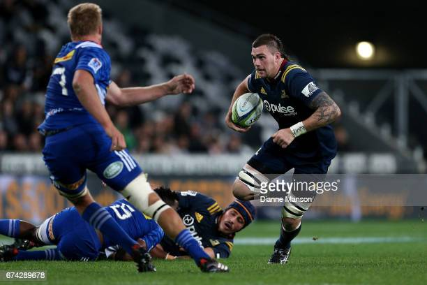 Liam Squire of the Highlanders runs the ball during the round 10 Super Rugby match between the Highlanders and the Stormers at Forsyth Barr Stadium...