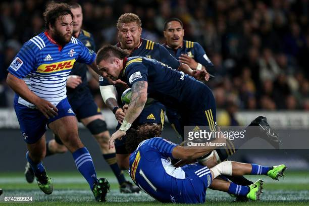 Liam Squire of the Highlanders tries to break through the tackle of Dillyn Leyds of the Stormers during the round 10 Super Rugby match between the...