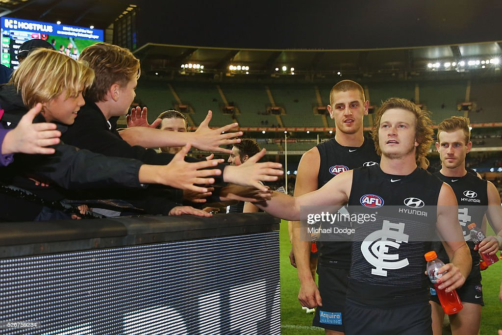 Liam Sumner of the Blues celebrates the win with fans during the round six AFL match between the Carlton Blues and the Essendon Bombers at Melbourne Cricket Ground on May 1, 2016 in Melbourne, Australia.