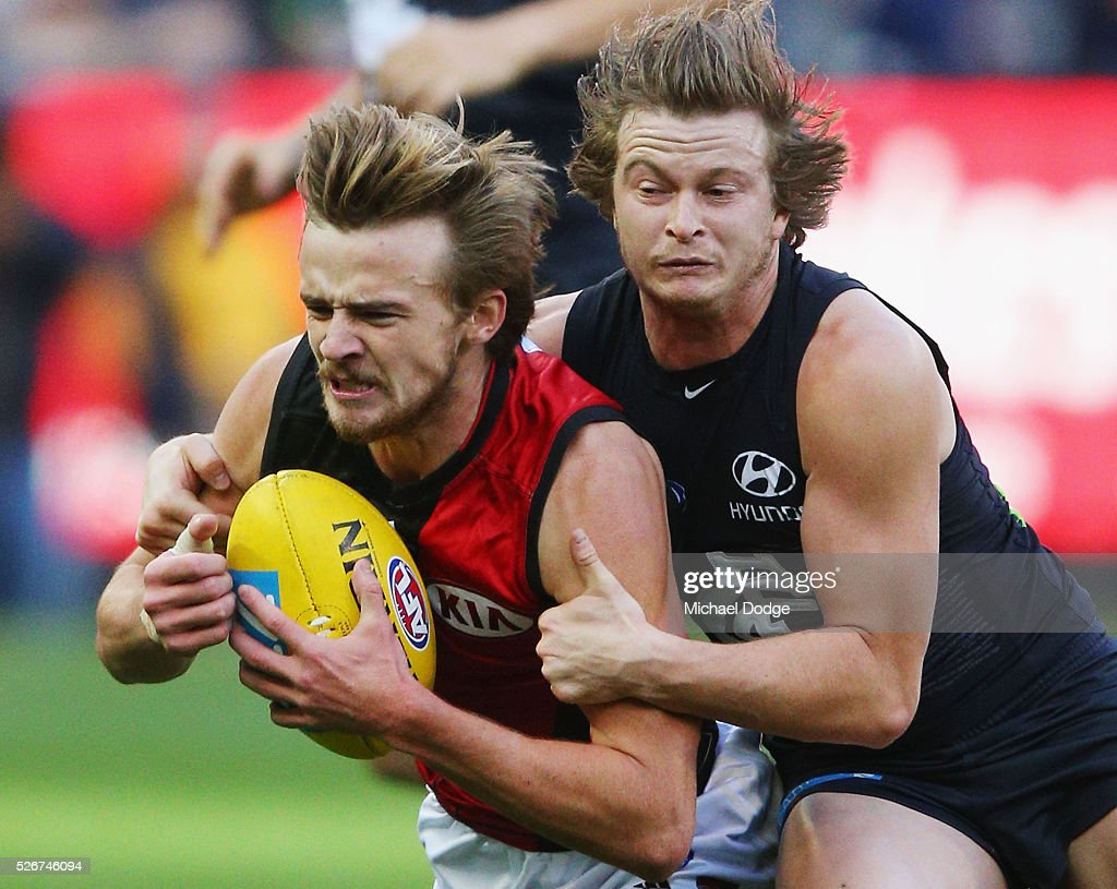 Liam Sumner of the Blues tackles Martin Gleeson of the Bombers during the round six AFL match between the Carlton Blues and the Essendon Bombers at Melbourne Cricket Ground on May 1, 2016 in Melbourne, Australia.