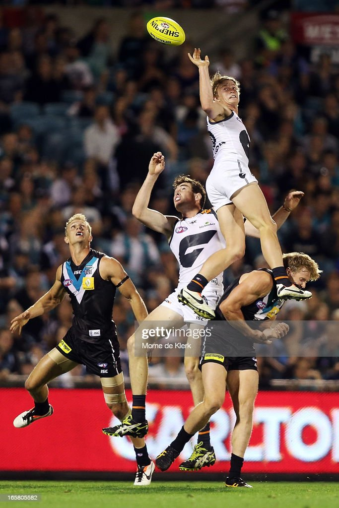 Liam Sumner of the Giants gets high but fails to take a mark during the round two AFL match between Port Adelaide Power and the Greater Western Sydney Giants at AAMI Stadium on April 6, 2013 in Adelaide, Australia.