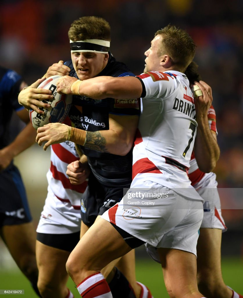 Liam Sutcliffe of Leeds is tackled by Josh Drinkwater of Leigh during the Betfred Super League match between Leigh Centurions and Leeds Rhinos at Leigh Sports Village on February 17, 2017 in Leigh, Greater Manchester.
