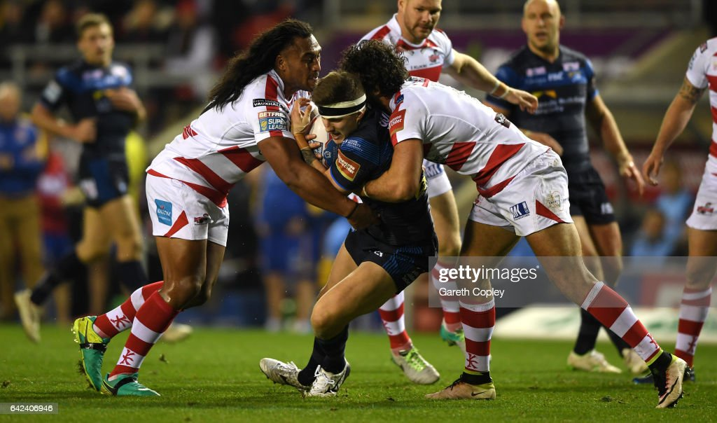 Liam Sutcliffe of Leeds is tackled by the Leigh defence during the Betfred Super League match between Leigh Centurions and Leeds Rhinos at Leigh Sports Village on February 17, 2017 in Leigh, Greater Manchester.