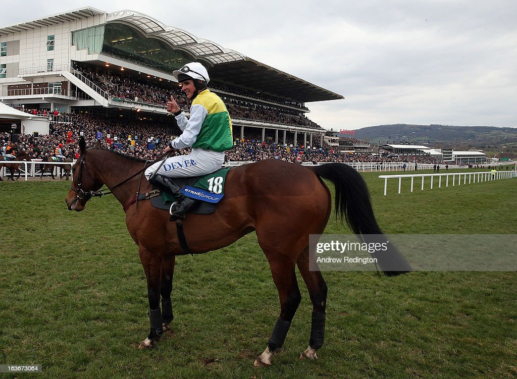 Liam Treadwell celebrates after riding Carrickboy to victory in the Byrne Group Plate during the Cheltenham Festival at Cheltenham Racecourse on March 14, 2013 in Cheltenham, England.