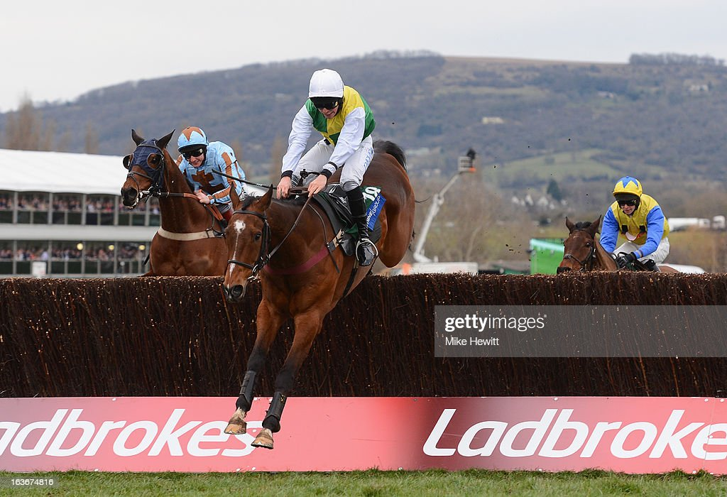 Liam Treadwell on Carrickboy clear the last on theiw way to victory in the Byrne Group Plate on St Patrick's Thursday at Cheltenham Racecourse on March 14, 2013 in Cheltenham, England.
