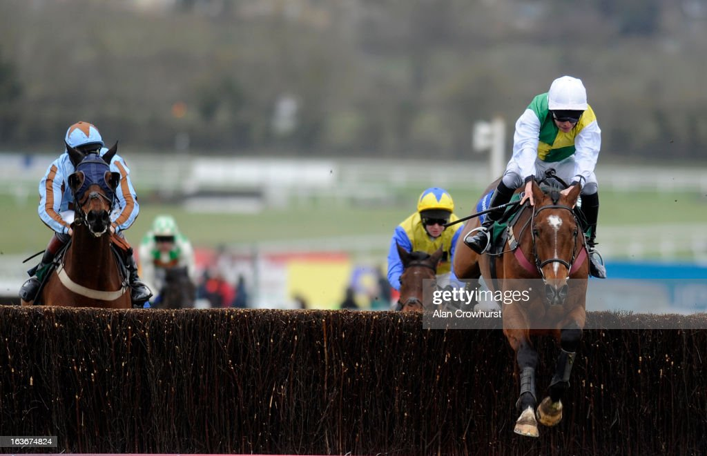 Liam Treadwell riding Carrickboy clear the last to win The Byrne Group Plate from Vino Griego (L) during St Patrick's Thursday at Cheltenham racecourse on March 14, 2013 in Cheltenham, England.
