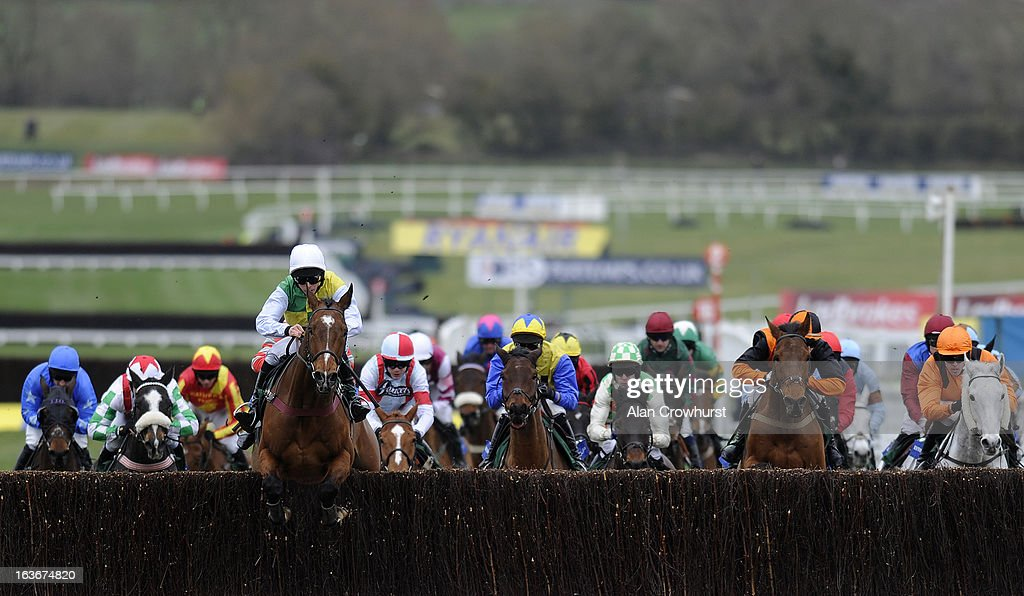 Liam Treadwell riding Carrickboy lead all the way to win The Byrne Group Plate from Vino Griego (L) during St Patrick's Thursday at Cheltenham racecourse on March 14, 2013 in Cheltenham, England.