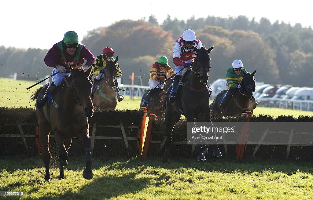 Liam Treadwell riding Stars Du Granitis (C, red( clear the last to win The Pertemps Handicap Hurdle Race at Exeter racecourse on November 14, 2012 in Exeter, England.