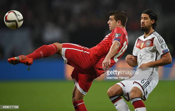 Liam Walker kicks the ball watched by Sami Khedira of Germany during the EURO 2016 Group D Qualifier match between Germany and Gibraltar at Grundig...
