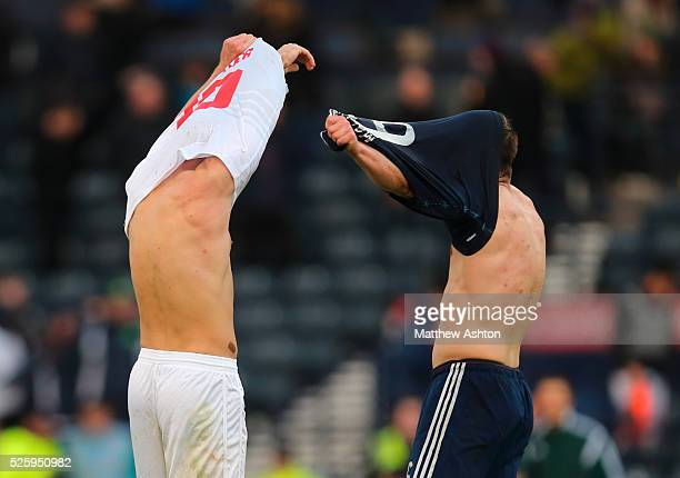Liam Walker of Gibraltar and Shaun Maloney of Scotland swap shirts at the end of the game