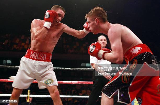 Liam Walsh and Joe Murray in action during the Commonwealth Vacant IBF International Superfeatherweight Championship bout at the Copper Box Arena...