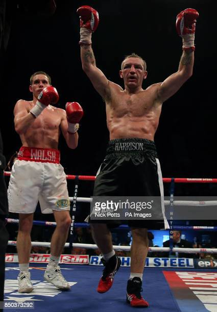 Liam Walsh and Scott Harrison react after the 12th round during the WBO European Lightweight Championship fight at Wembley Arena London