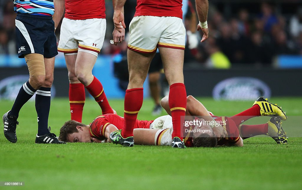 Liam Williams lies face down on the pitch as Dan Biggar lays on his back during the 2015 Rugby World Cup Pool A match between England and Wales at...