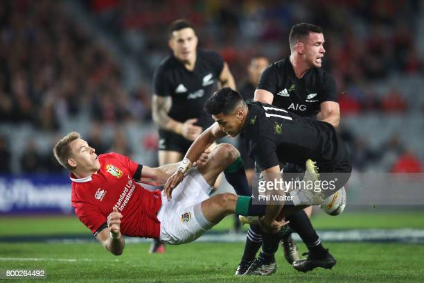 Liam Williams of the Lions is tackled by Rieko Ioane of the All Blacks during the first test match between the New Zealand All Blacks and the British...