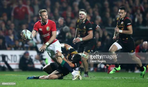 Liam Williams of the Lions moves away from Jonathan Taumateine to set up a try for Jared Payne during the match between the Chiefs and the British...