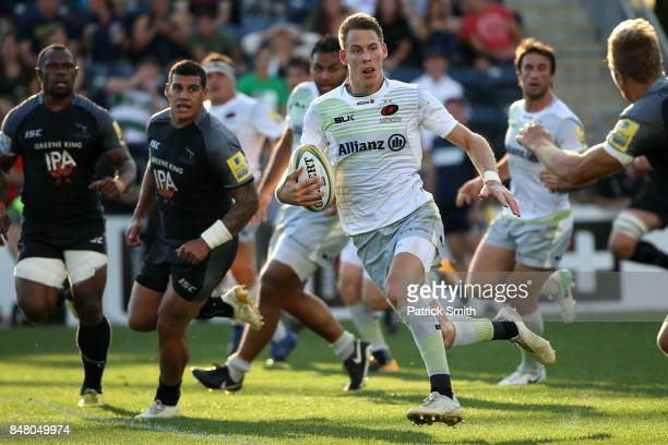 Liam Williams of the Saracens runs up the field with the ball against the Newcastle Falcons during a Aviva Premiership match between the Newcastle...